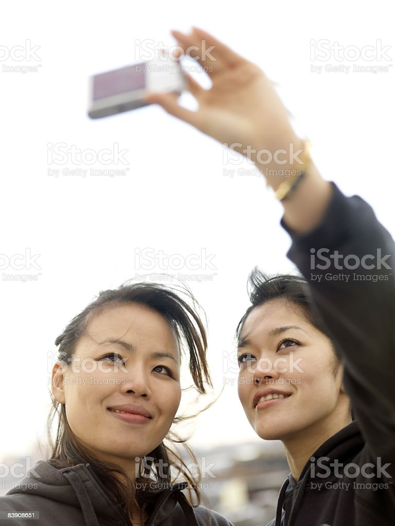 Two friends pose for a self portrait. royalty-free stock photo