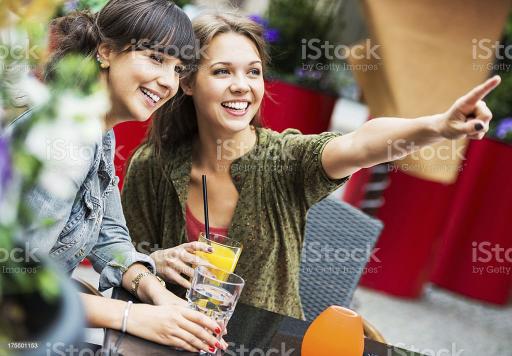 Two  friends sitting in a cafe and looking at distance. royalty-free stock photo