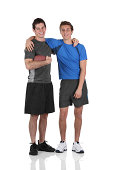 istock Two friends standing with a football 184137354