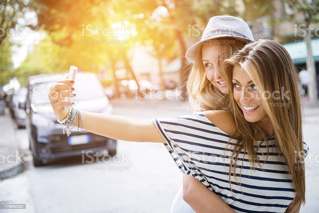 Two friends take a photo together royalty-free stock photo