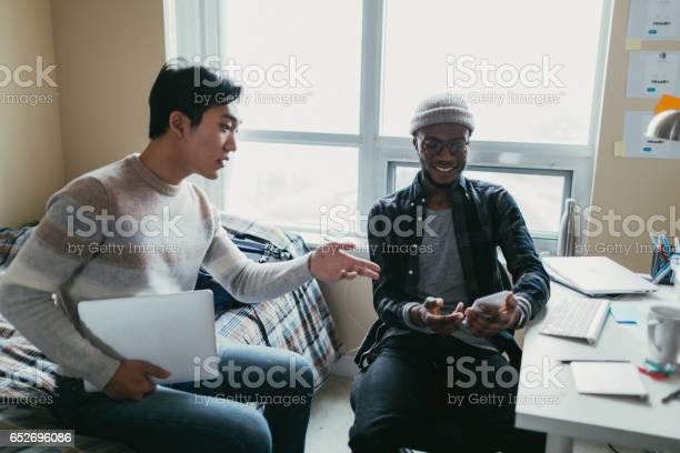 Two friends talking in a dorm room picture id652696086?b=1&k=6&m=652696086&s=612x612&h=qw0jncglionoaoc8d7ckvrxfgnmel6yxc1ukex3qzck=