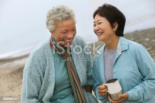 Two Friends Talking over Coffee on the Beach
