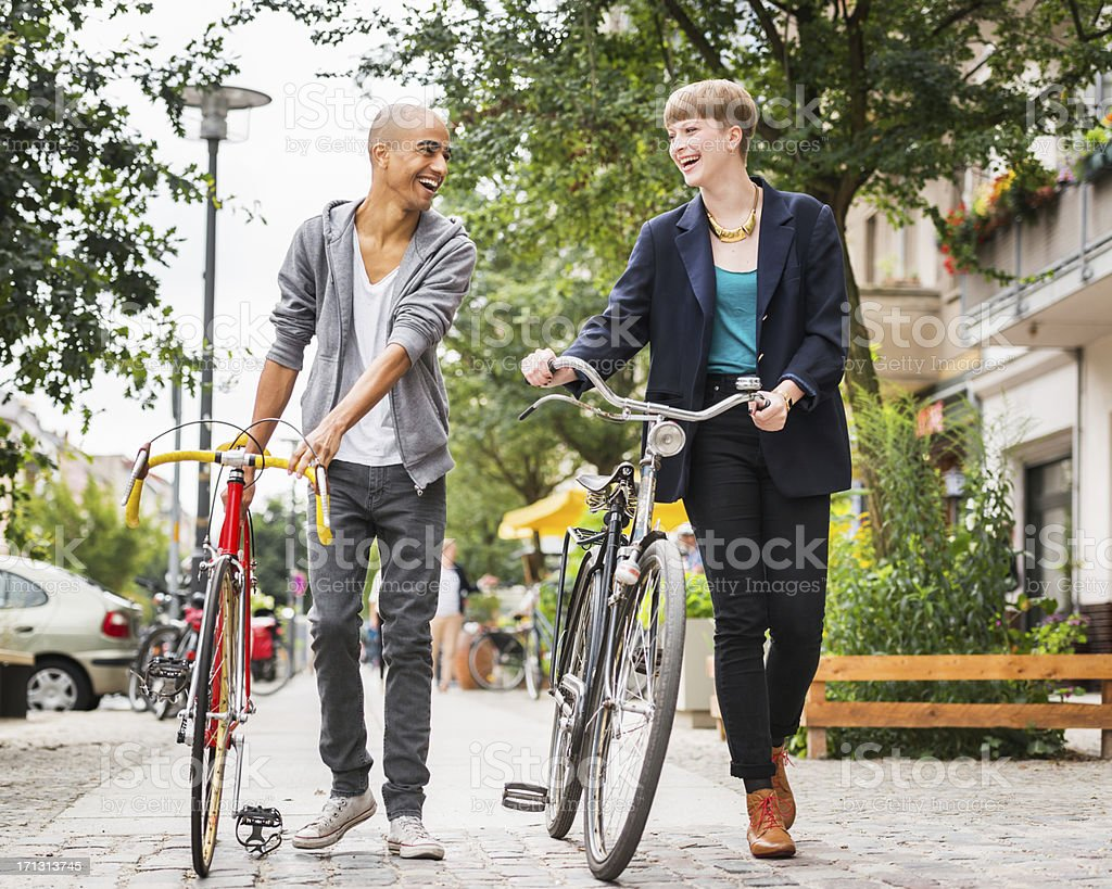 Two Friends Walking in Berlin, Germany royalty-free stock photo