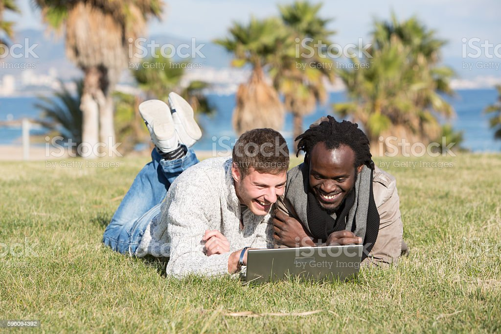 Two friends watching the laptop pc royalty-free stock photo
