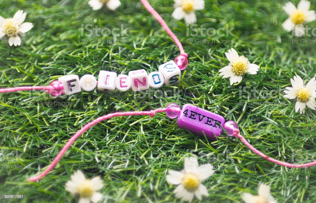 two friendship bracelet on grass stock photo
