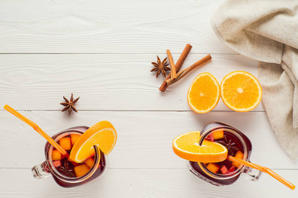 Two fruit tea in vintage glass jars stock photo
