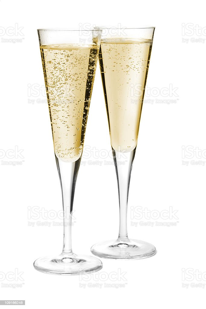 Two full champagne flutes on a white background stock photo