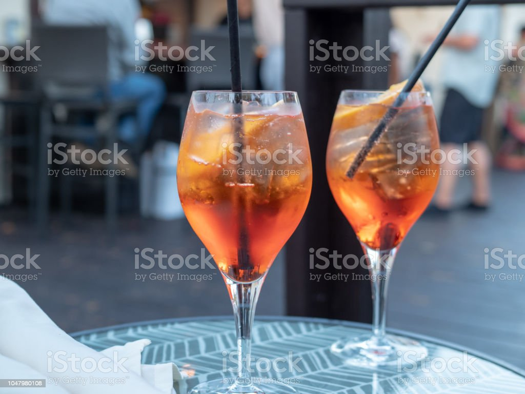 Two full spritz drinks sitting on outdoor table in restaurant stock photo
