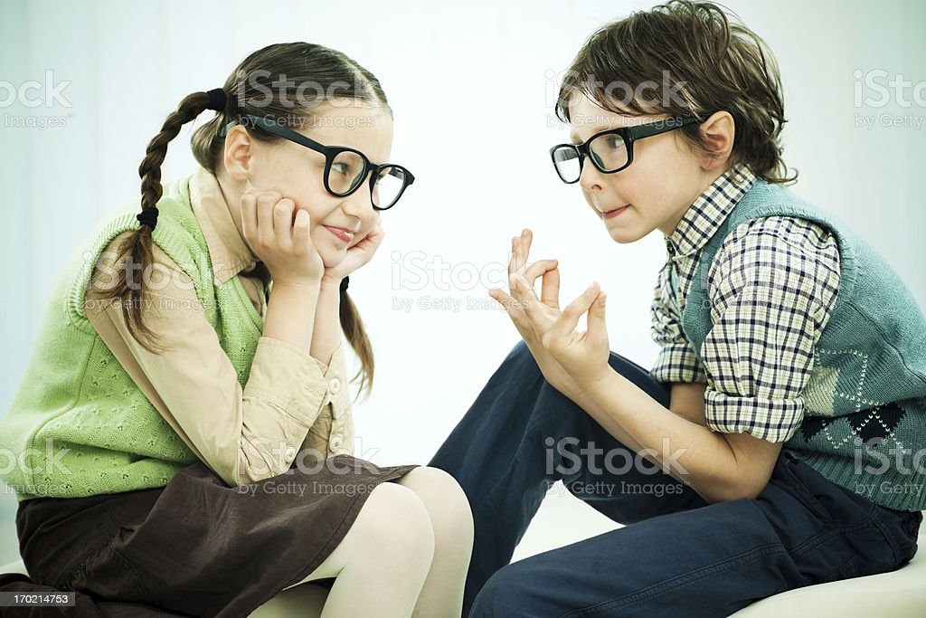 Two funny looking nerds talking stock photo