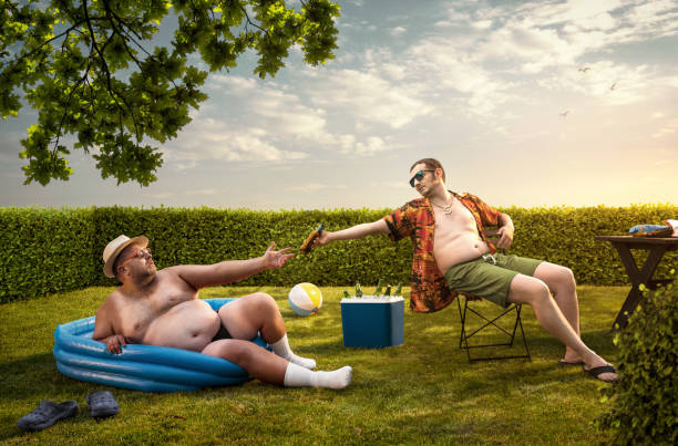 Two funny nerds relaxing in the backyard on the summer day stock photo