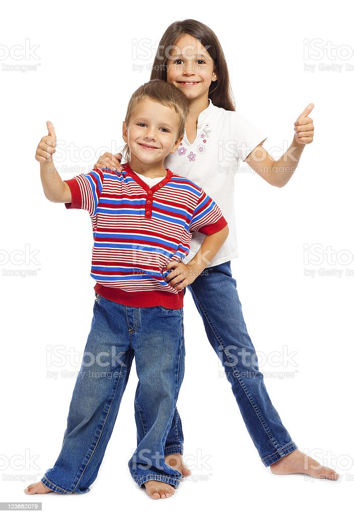 Two funny smiling little children with thumbs up sign royalty-free stock photo