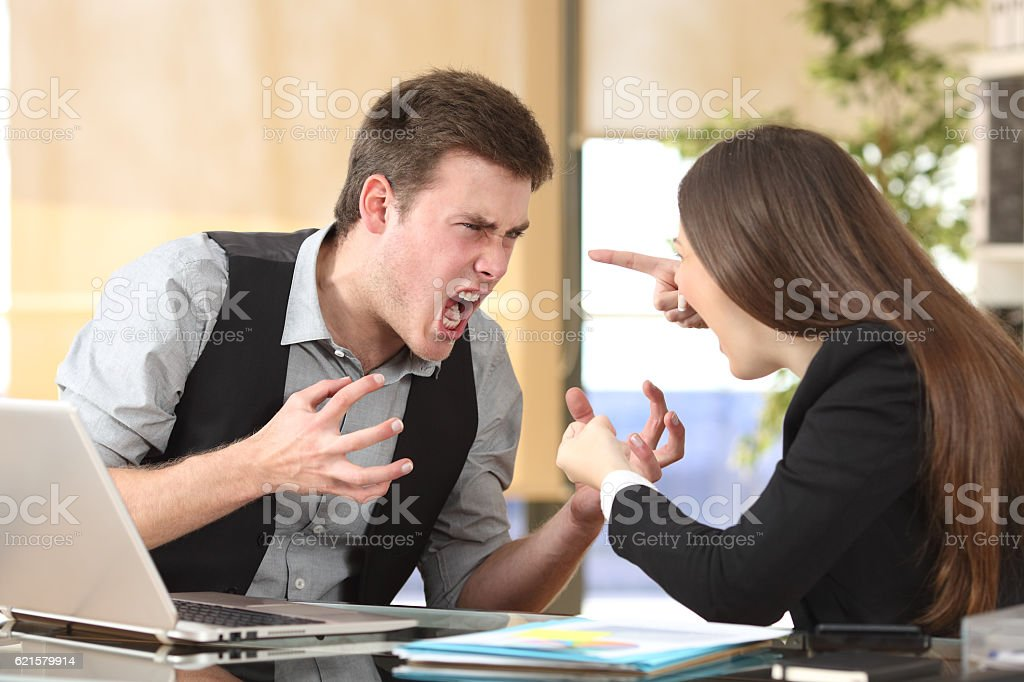 Two furious businesspeople arguing at office stock photo