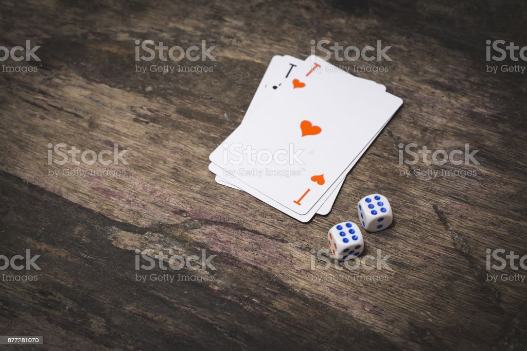 two game dice number six and ace of hearts playing cards with...
