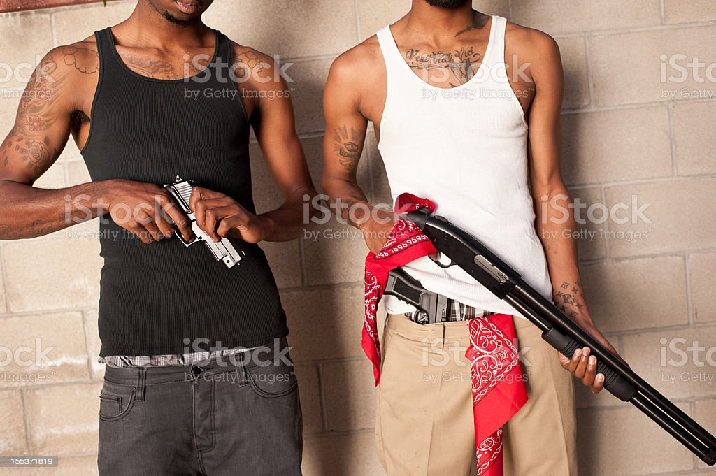 two gangbangers with guns stock photo