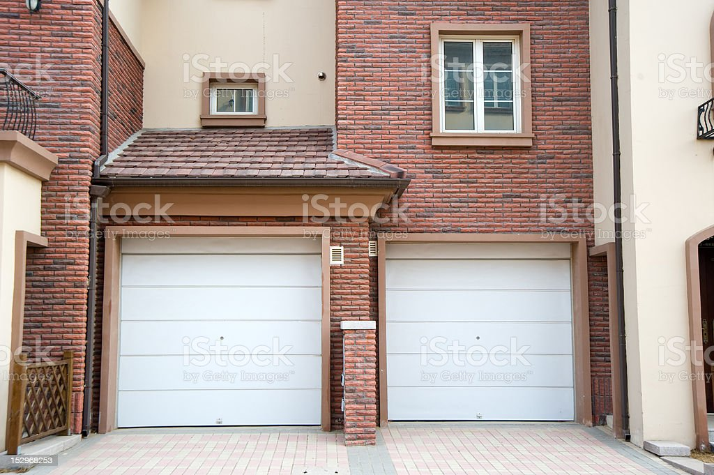 Two garage door of a residence building stock photo