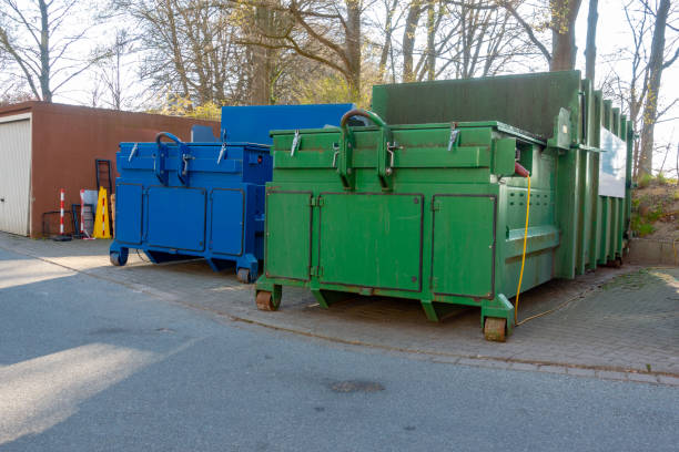 two garbage compactors are standing in the courtyard of a hospital two garbage compactors are standing in the courtyard of a hospital compactor stock pictures, royalty-free photos & images