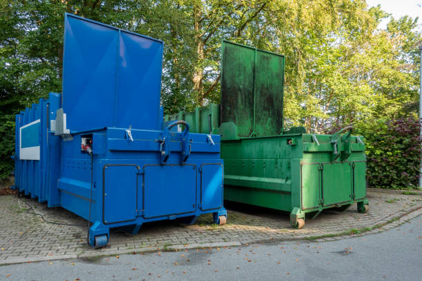 two garbage compactors Standing next to each other on the premises of a hospital two garbage compactors Standing next to each other on the premises of a hospital compactor stock pictures, royalty-free photos & images