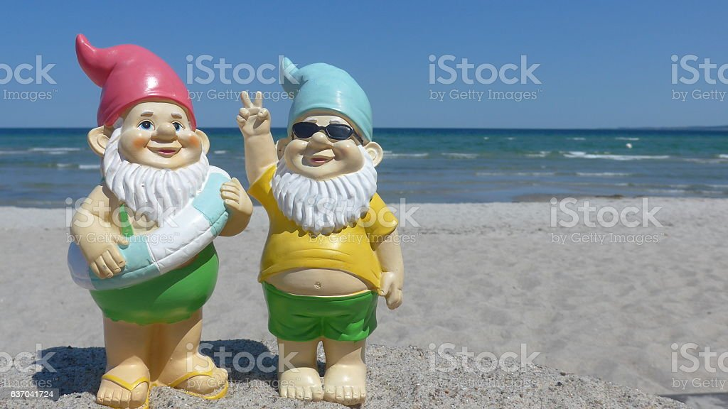 Two garden dwarfs on vacation at sea stock photo