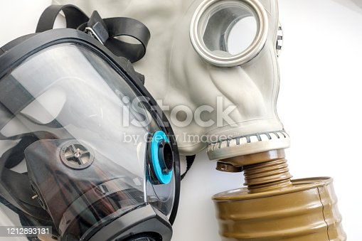 istock two gas masks next to each other 1212893131