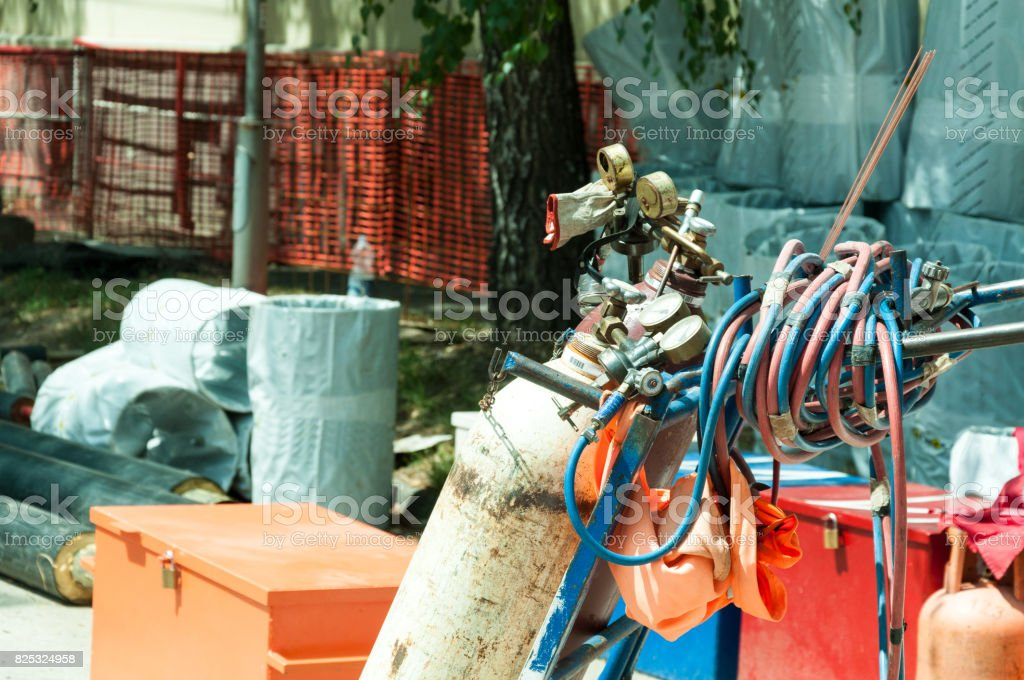 Two gas tank for welding with pressure gauge and hose on the trolley in street construction site. stock photo
