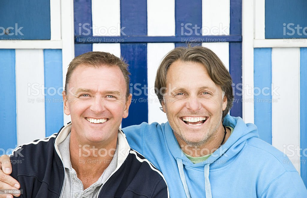 Two gay men laughing together. royalty-free stock photo