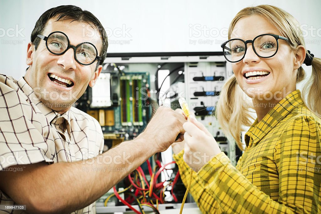 Two geeks fixing a computer. royalty-free stock photo