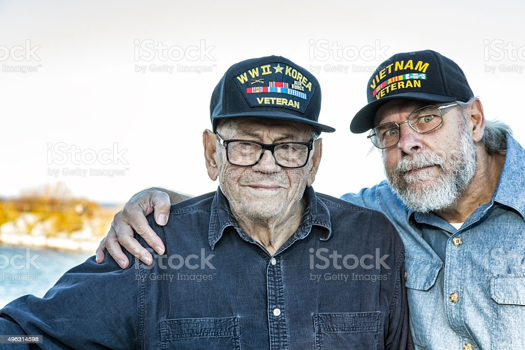 Two Generation Family USA Military War Veterans stock photo