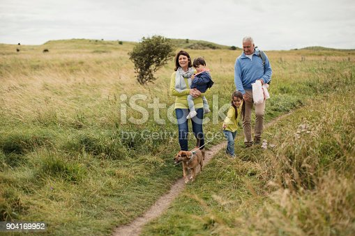 istock Two Generation Out Walking 904169952