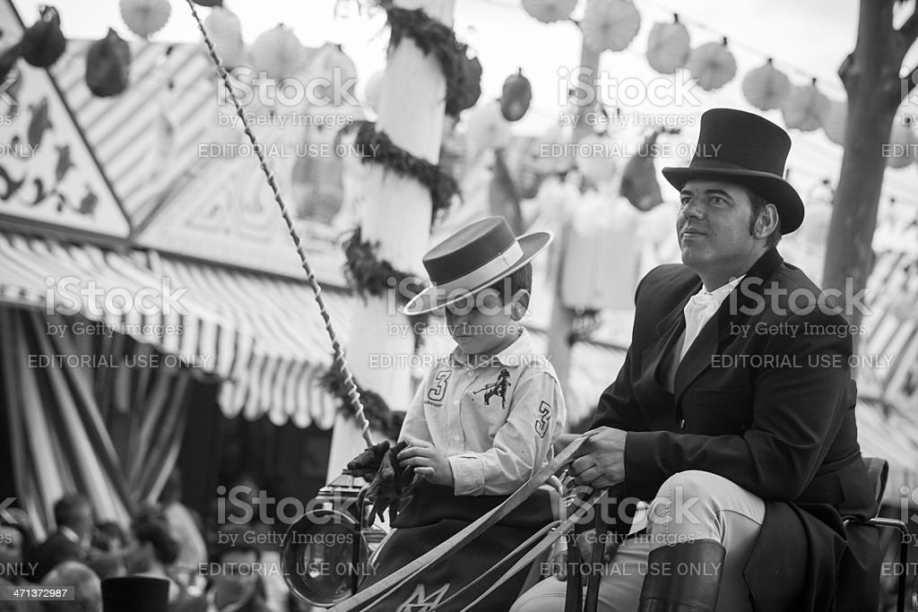 two generations coachmen on the Fair of Seville royalty-free stock photo