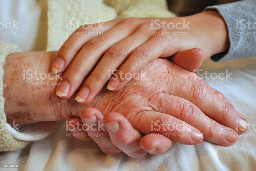Two Generations embracing and Holding Hands stock photo