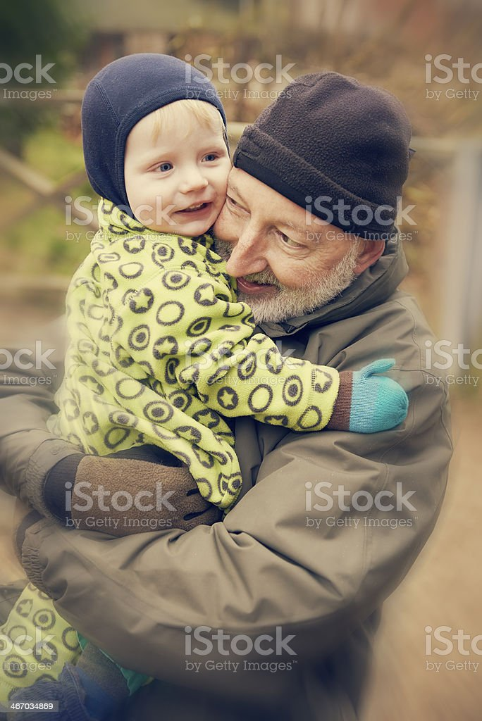 Two generations hugging royalty-free stock photo