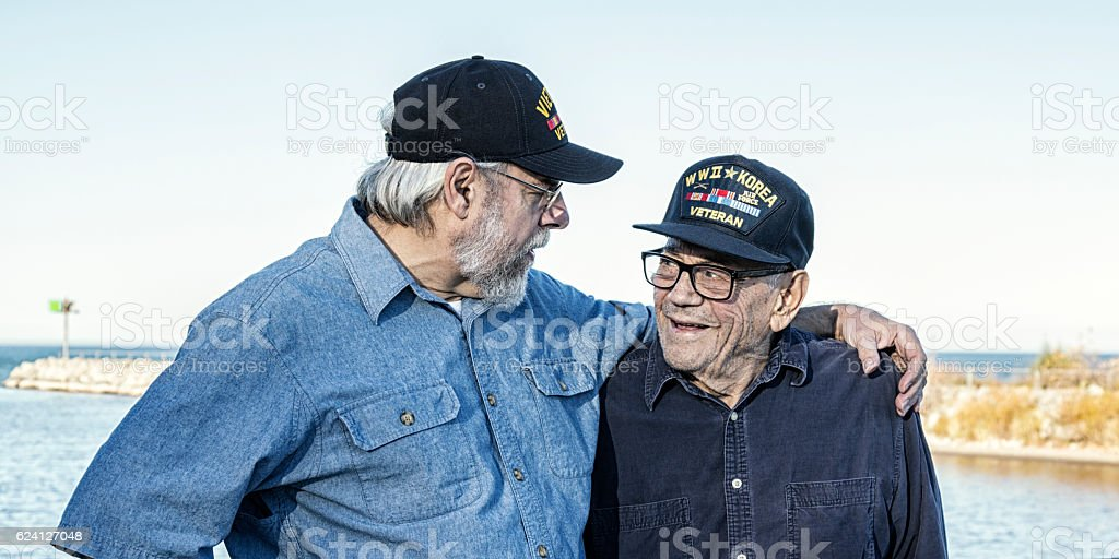 Two Generations of USA Military War Veterans Telling War Stories stock photo