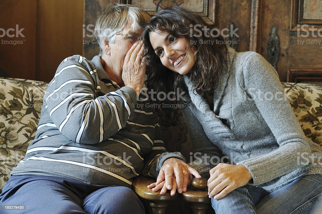Two generations sharing secrets royalty-free stock photo