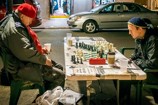 Two gentlemen playing a game of chess on a street, New Orleans