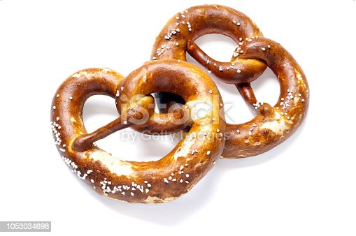 Two German bread pretzels on a white background