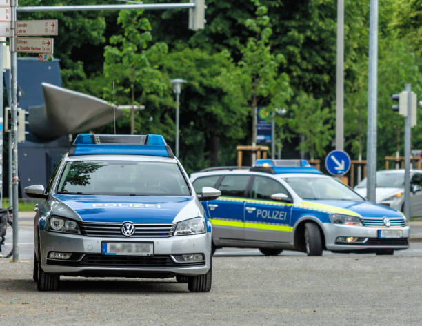 two german police cars with grey and blue markings waiting to be used - язык знаковая система стоковые фото и изображения