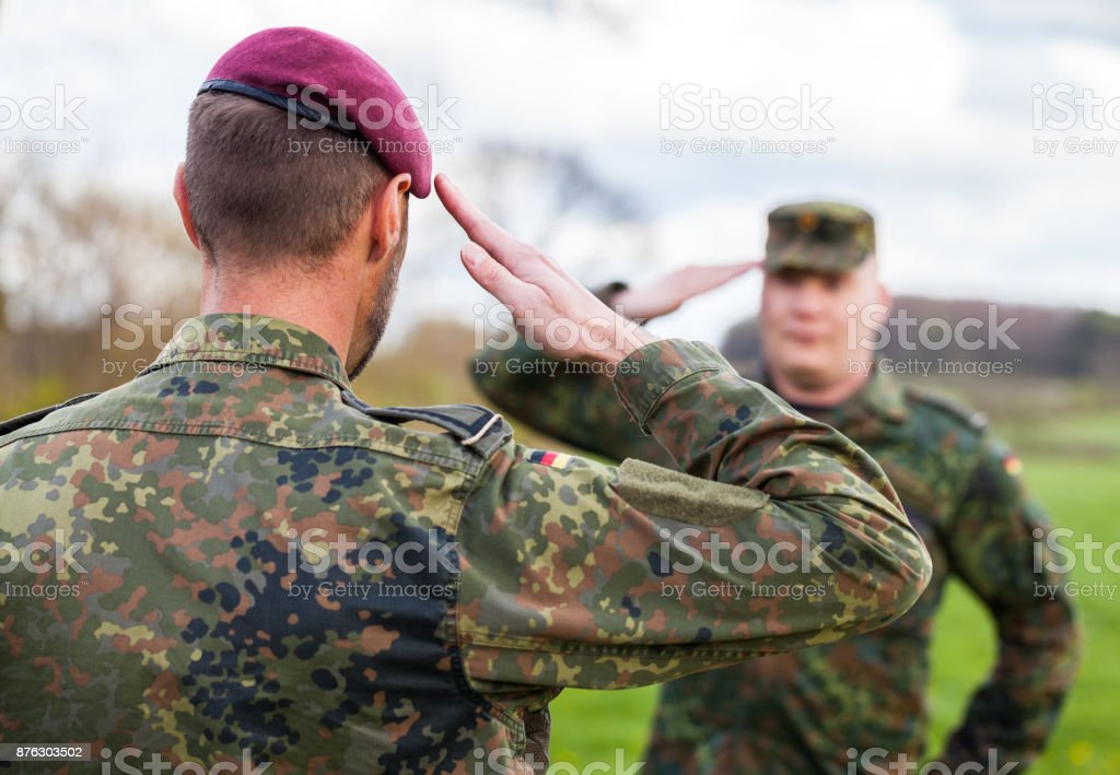 two german soldiers salute each other stock photo