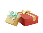 istock two gift boxes (yellow gold box with mint green ribbon bow and red box with golden ribbon bow) isolated on white background 877325230