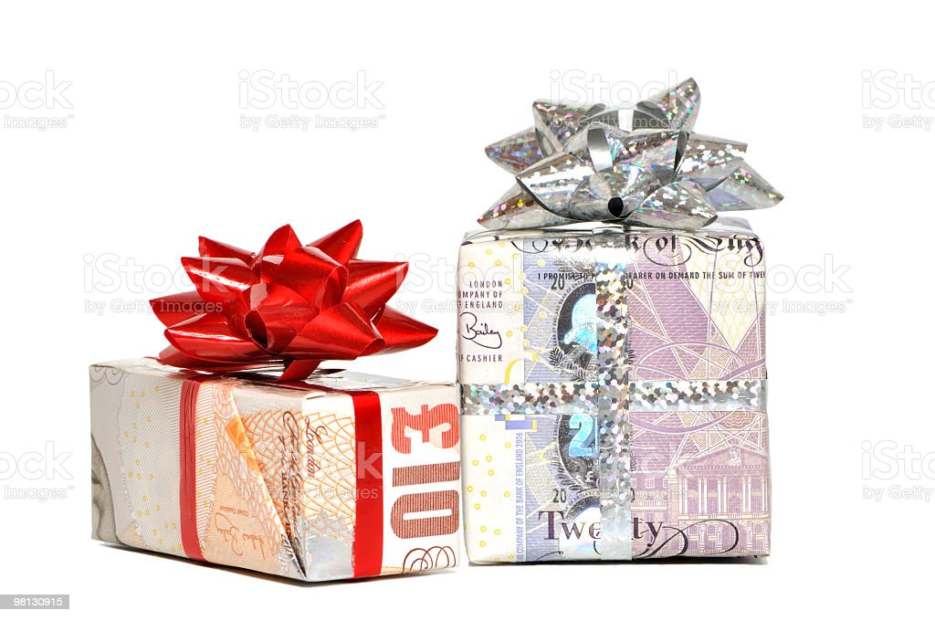 Two gift boxes wrapped with paper money and topped with bows royalty-free stock photo
