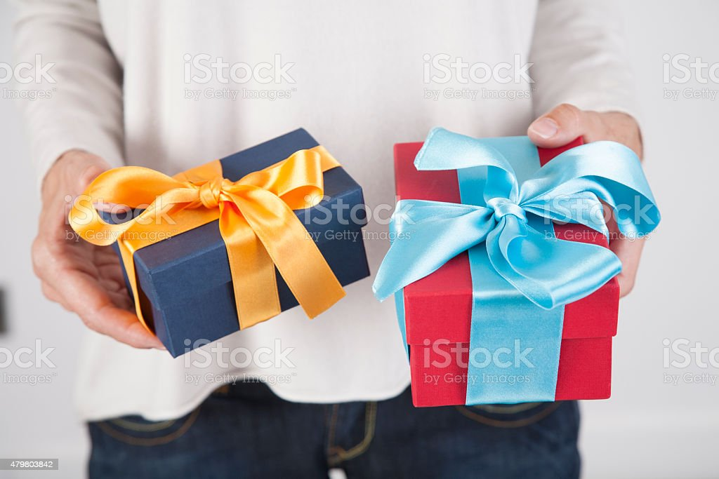 two gifts in woman hands stock photo