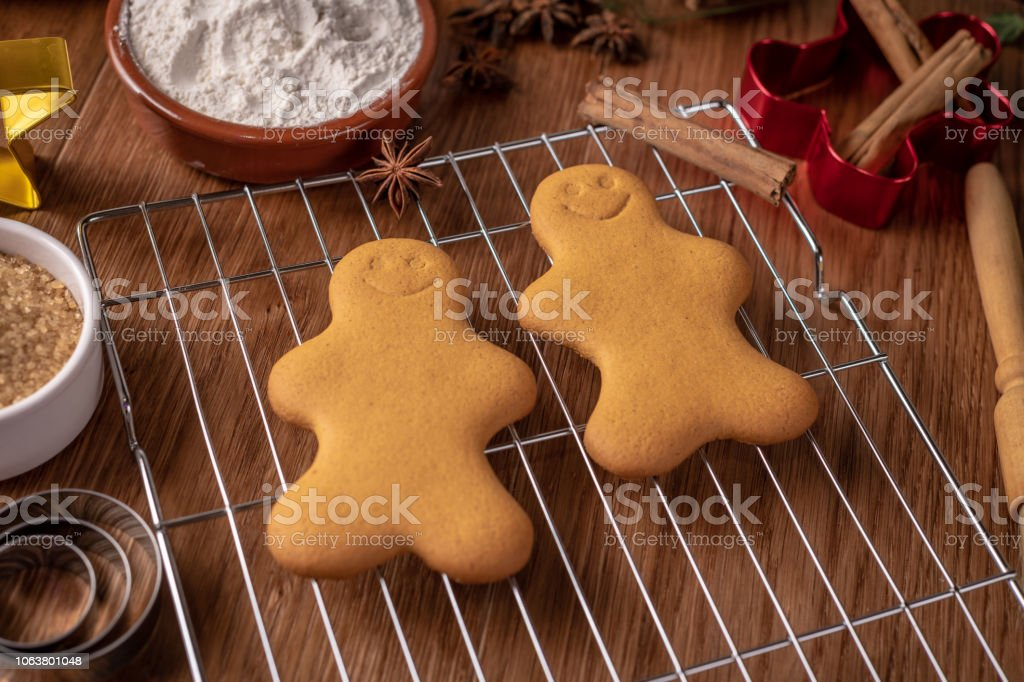 Two Gingerbread characters on a wire reack stock photo