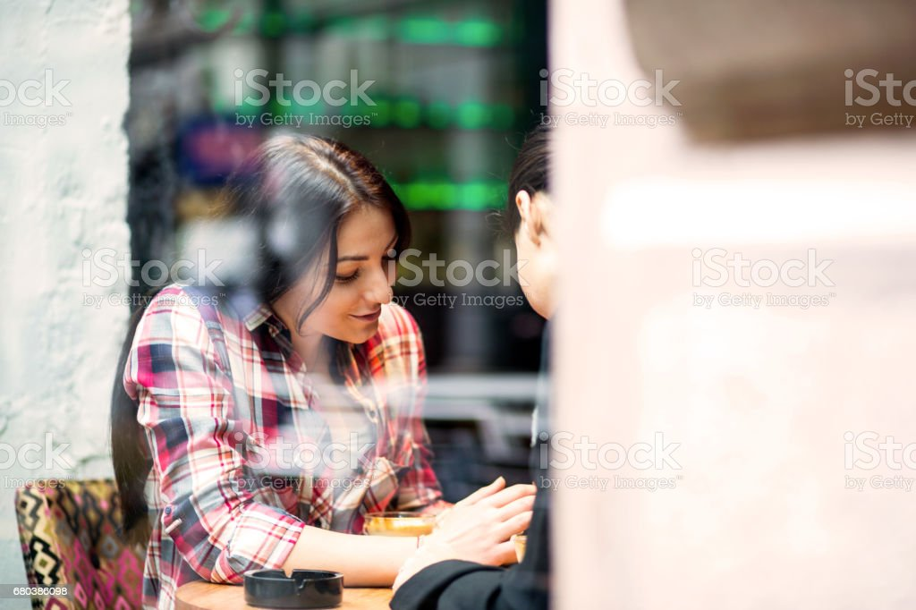 Two girl enjoy a coffee break royalty-free stock photo