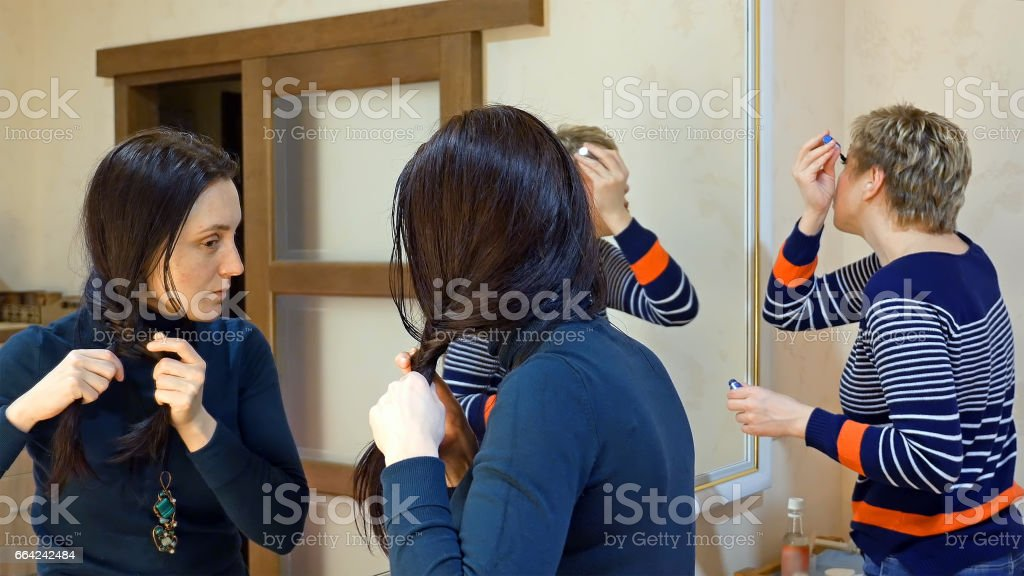 Two girl friends gossiping in dressing makeup room stock photo