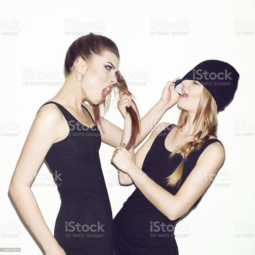 Two girl friends having quarrel stock photo