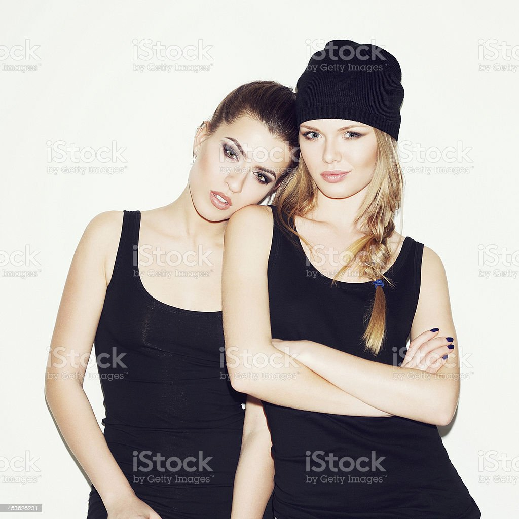 Two girl friends standing together stock photo
