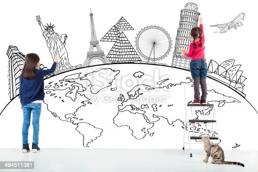 istock two girl kids drawing global map and famous landmark 494511381