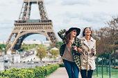 Two girlfriends enjoying walk in Paris