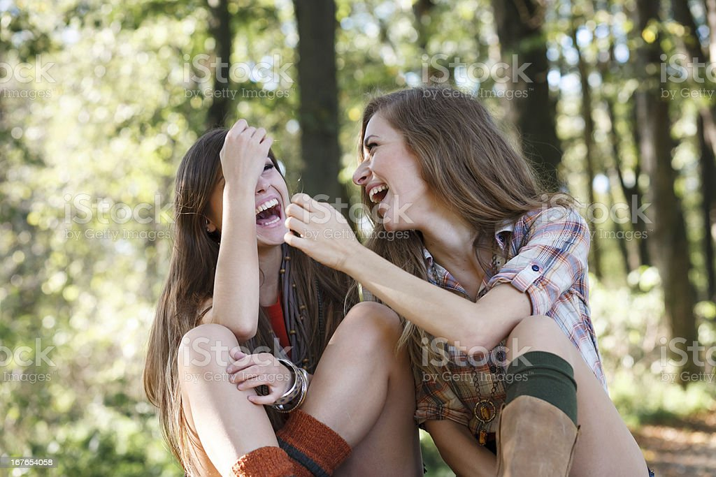 two girlfriends outdoor laughing royalty-free stock photo