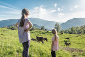 Two Girls Admiring the Beauty of the Spring Mountain Pasture