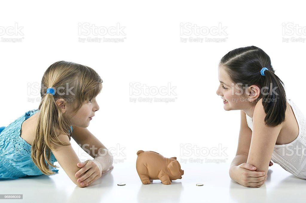 two girls and piggy bank royalty-free stock photo